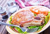 stock photo of shoulder-blade  - fried meat with salad on plate and on a table - JPG