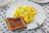 image of scrambled eggs  - Closeup of scrambled eggs and toast on white plate - JPG