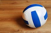 image of volleyball  - Volleyball ball on wooden background - JPG