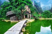 picture of dong  - Outdoor park landscape with lake and stone bridge - JPG