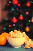 pic of tangerine-tree  - Sweet tangerines and oranges on table on Christmas tree background - JPG
