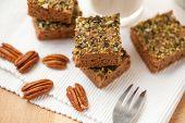 stock photo of pecan  - Home made pumpkin paleo brownies with pecans  - JPG