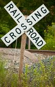 stock photo of railroad-sign  - Railroad crossing sign on a hill road