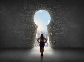 foto of keyholes  - Business woman looking at keyhole with bright cityscape concept background - JPG