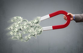 picture of horseshoe  - Businessman attracting money with a horseshoe magnet concept for business success - JPG
