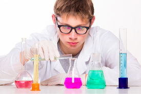 stock photo of chemical reaction  - Young Scientist Doing Chemical Reactions In The Laboratory - JPG
