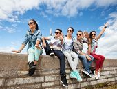 picture of teenagers  - summer holidays and teenage concept  - JPG