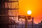 stock photo of scaffold  - Scaffolding silhouette at sunset - JPG