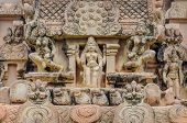 foto of tamil  - Hindu God statue on a wall in Hindu Brihadeeswarar Temple Thanjavur Tamil Nadu India - JPG