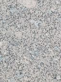 picture of slab  - light speckled granite stone with small gray patches in the slab - JPG