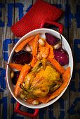 stock photo of root-crops  - The chicken baked with root crops - JPG