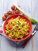 stock photo of saffron  - pasta with saffron cream sauce and sliced vegetables - JPG