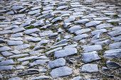 stock photo of paved road  - Detail of a cobbelstone road located in the North of France near Lille - JPG