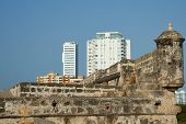 picture of fortified wall  - Modern apartment block towering above the fortified walls of the historic Spanish colonial city of Cartagena de Indias in Colombia - JPG