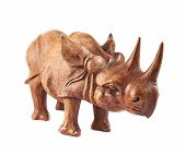 foto of rhino  - Rhinoceros rhino sculpture made of carved brown wood isolated over white background - JPG