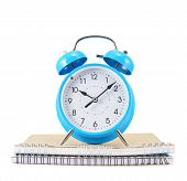 stock photo of time study  - Time to study composition as a blue alarm clock over two notebooks - JPG