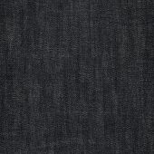 stock photo of denim jeans  - Black jeans denim cloth fragment as a background texture composition - JPG