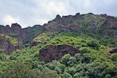 stock photo of armenia  - mountains and cliffs surrounding Azat river and Geghard monastery in Armenia
