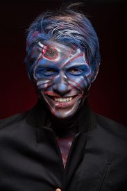 foto of mauri  - A creepy portrait of a halloween man with bloody body art and face art - JPG