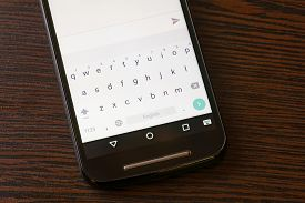picture of qwerty  - A luminous smartphone keypad with qwerty text map - JPG