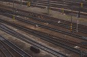 foto of railroad yard  - Aerial Top View of Intersecting Rails at Train Railway Station - JPG