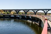 picture of dam  - arch bridge the railway line on a dam in a swamp - JPG