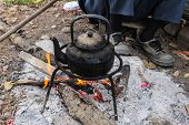 foto of boiling water  - Old Kettle Boiling Water For Coffee Or Tea In Countryside In Thailand - JPG