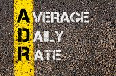 pic of average looking  - Concept image of Business Acronym ADR as Average Daily Rate written over road marking yellow paint line - JPG