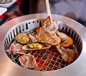 picture of braai  - Mixed Roasted Meat and Seafood and Chopsticks on the BBQ Grill on roast - JPG
