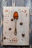 pic of saffron  - Spice Saffron in old metal spoon over wooden background - JPG