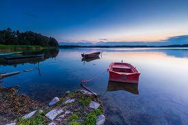 foto of dock a lake  - Beautiful lake sunset with fisherman boats - JPG