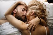 Young Adult Heterosexual Couple Lying On The Bed In The Bedroom poster