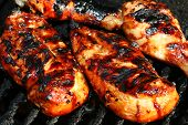 picture of barbecue grill  - grilled chicken meat on the grill ready for eating - JPG