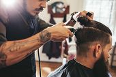 Man Getting Trendy Haircut In Barber Shop poster