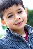 Young Boy Smiling Outdoors poster