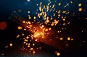 artistic welding sparks light, industrial background poster