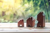 Small House With Key Placed On Wooden Table On Natural Background.concept For Property Ladder, Mortg poster