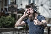 Man Bearded Hipster With Headphones Listening Music. Hipster Enjoy High Quality Sound Of Song In Hea poster