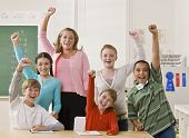 stock photo of student teacher  - Teacher and students cheering - JPG