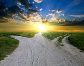 stock photo of steppes  - rural road to sunset - JPG