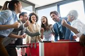 Excited Diverse Employees Enjoying Funny Activity At Work Break, Creative Friendly Workers Play Game poster