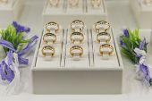 Golden Rings Store. Wedding Gold Rings On The Showcase. Wedding Ring Set. poster