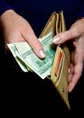 foto of tithe  - woman taking money out of his wallet - JPG