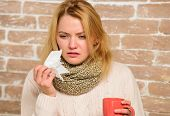 Woman Feels Badly Ill Sneezing. Girl In Scarf Hold Tea Mug And Tissue. Runny Nose And Other Symptoms poster