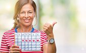 Middle age senior hispanic woman holding menstruation calendar over isolated background happy with b poster