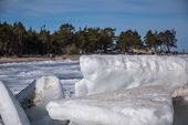 Frozen Baltic Sea Coastline Covered With Stack Of Ice Floes And Blue Sky poster