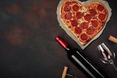 Heart Shaped Pizza With Mozzarella, Sausagered With A Bottle Of Wine And Wineglas. Valentines Day Gr poster