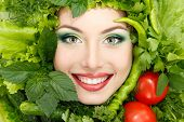stock photo of pretty girl  - greens vegetables frame woman beauty face isolated on white background - JPG