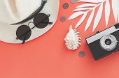 Flatlay Traveler Accessories On Yellow Background With Palm Leaf, Coin, Shell, Old Camera And Sungla poster