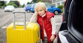 Tired Toddler Boy Ready For Going To Road Trip With His Parents. Automobile Trip In The Countryside. poster